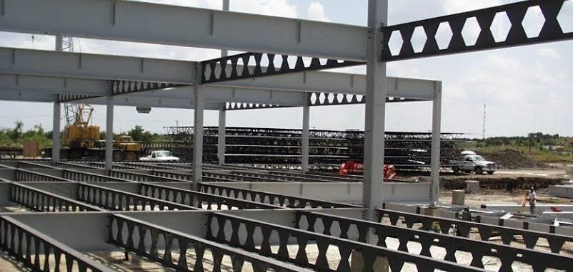 Builder Welding On High Rise Steel Frame