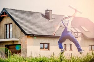 man jumping after finishing house