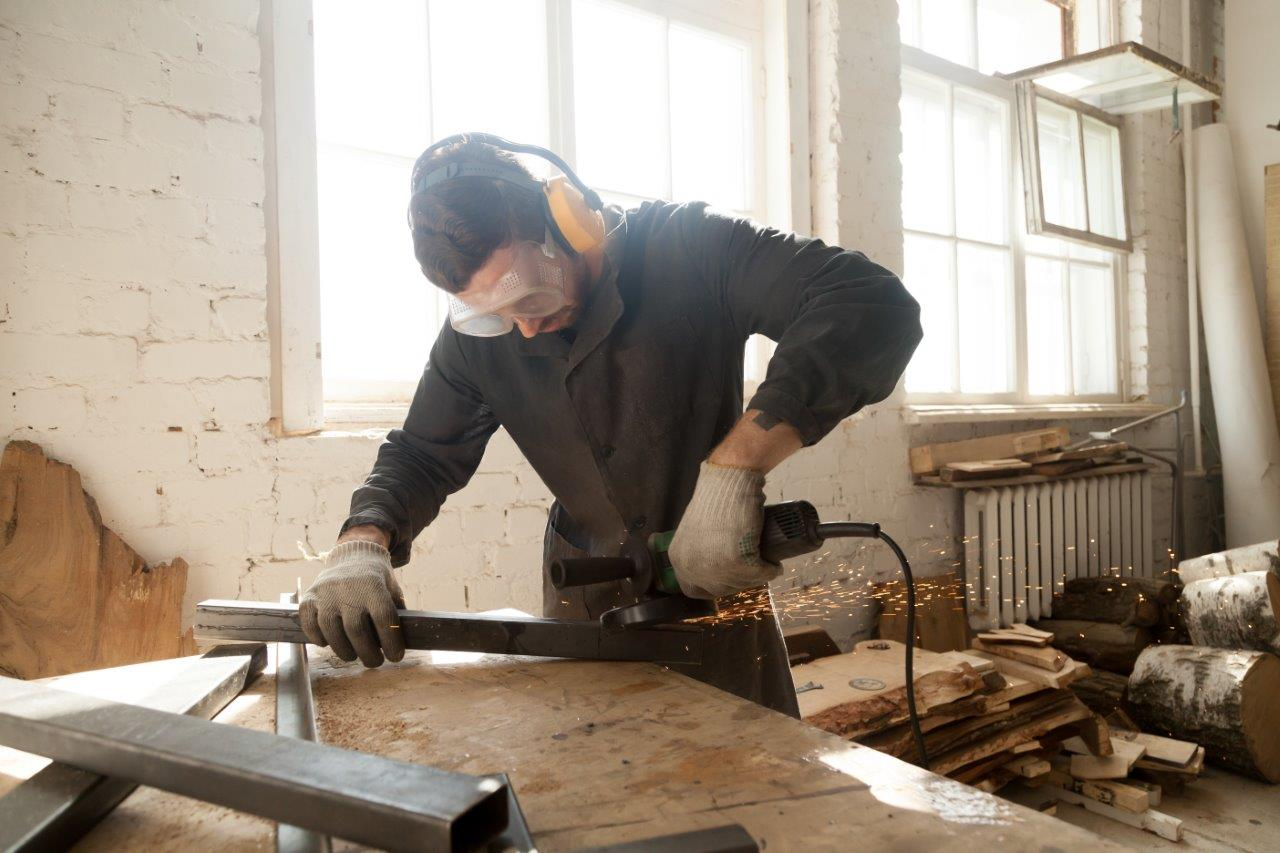 man working with steel