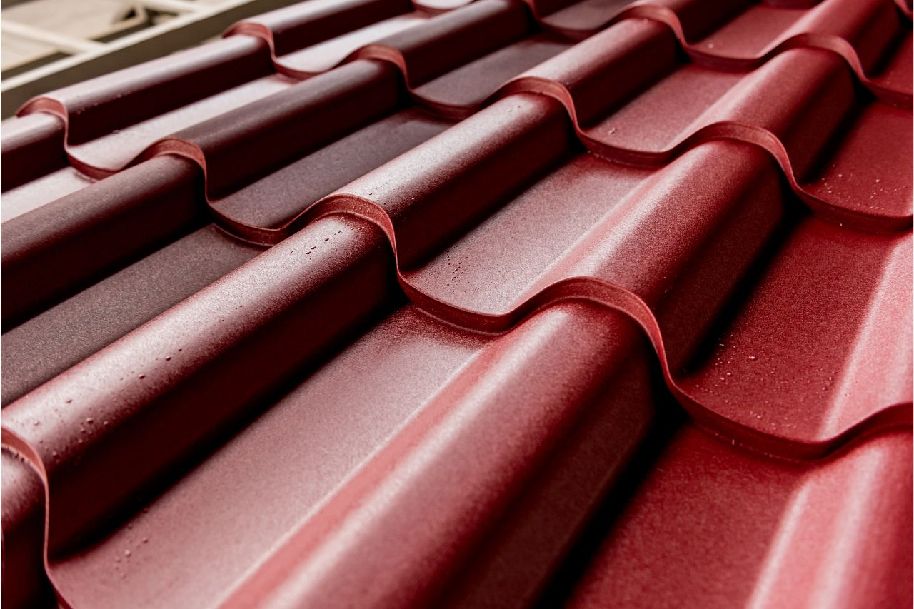 Close up of a red corrugated metal roof