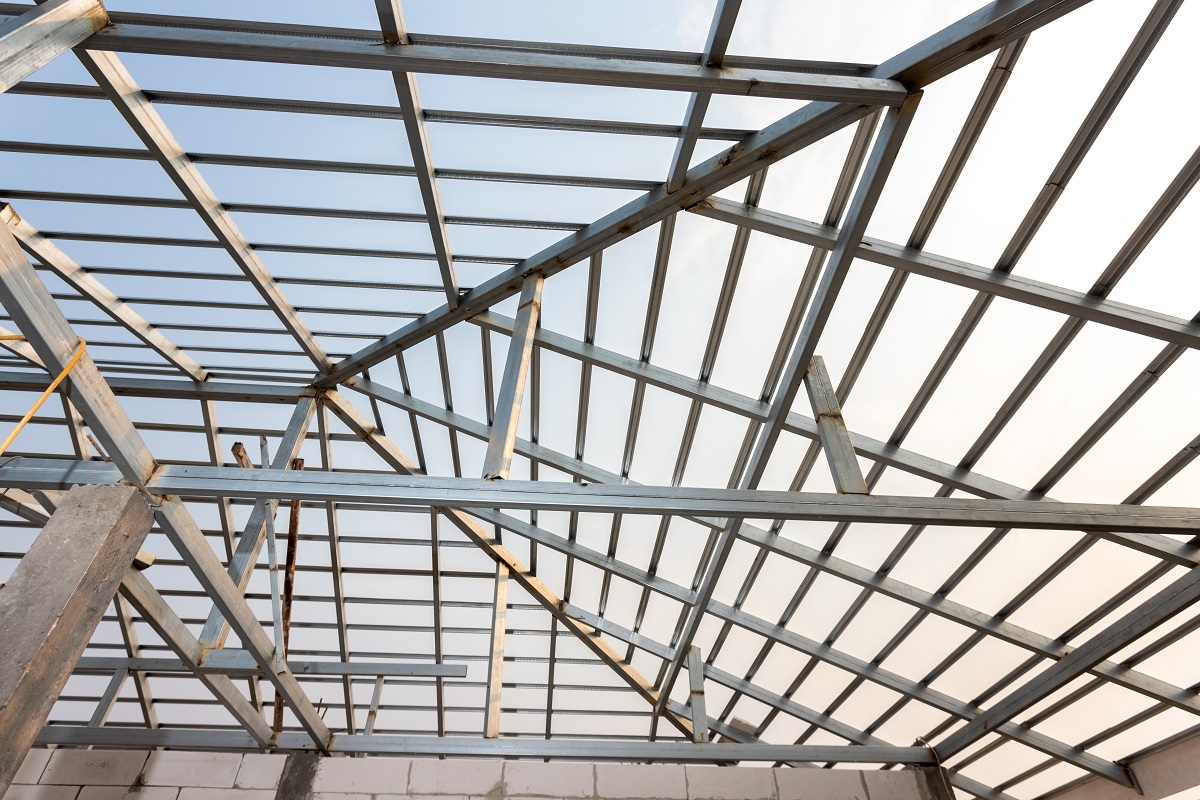 Structure of steel roof frame for home construction. Concept of